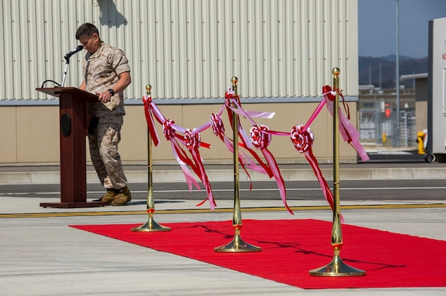 Maj. Gen. Juan G. Ayala, commander of Marine Corps Installations Command, gives his remarks of the new hangars and buildings during the Marine Aircraft Group 12 and Marine Aviation Logistics Squadron 12 ribbon cutting ceremony aboard Marine Corps Air Station Iwakuni, Japan, March 27, 2014. The Defense Policy Review Initiative built the new facilities as part of the ongoing construction focused on rebuilding 77 percent of the station.