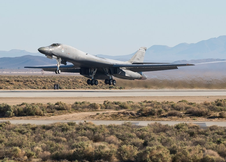 A B-1B Lancer takes off to begin testing its new Sustainment Block 16A, or SB 16A, software upgrades April 1, 2014, at Edwards Air Force Base, Calif. The SB 16A software will work in conjunction with the long-range bomber's new glass cockpit configuration in order to ensure its capabilities in a fast-paced integrated battlefield of the future. The B-1 is assigned to Edwards AFB. (U.S. Air Force photo/Ethan Wagner)