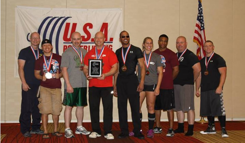 The Air Force team receives the second place award at the 2014 U.S. Military National Powerlifting Championships March 15, 2014, in Killeen, Texas. At the event, Chief Master Sgt. Troy Saunders, Pacific Air Forces vehicle management functional manager (fourth from left), earned 11 gold medals, five military national and four American records. (Courtesy photo)