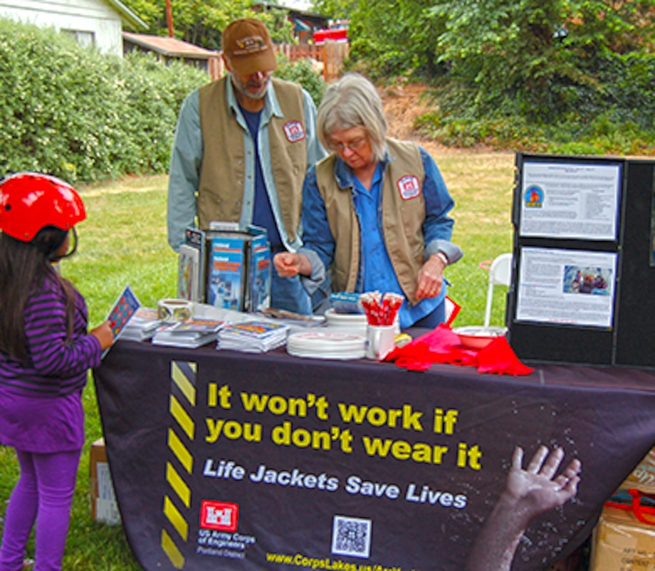 Tom and Velda Pierce have volunteered for events at The Dalles Lock and Dam for the past three and a half years, providing key support for popular events such as the Annual Eagle Watch, the Kids Fishing Day at Spearfish Park, and most recently helped during the Amazing Race Geocache event. In this photo, Tom and Velda are sharing information about the importance of water safety and wearing life jackets at the 2012 Childrens Safety Fair.