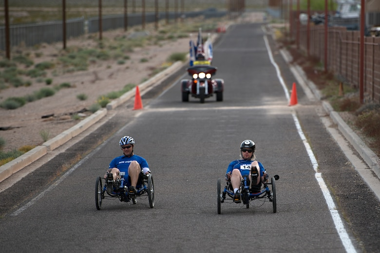 Athletes race to the finish during the men's recumbent heat April 9, 2014, during the Air Force Trials at Nellis Air Force Base, Nev.  During the trials, injured, ill and wounded Airmen compete in Paralympic-type events to identify which members will be selected for the Warrior Games and Invictus Games teams.  (U.S. Air Force photo/Senior Airman Jette Carr)