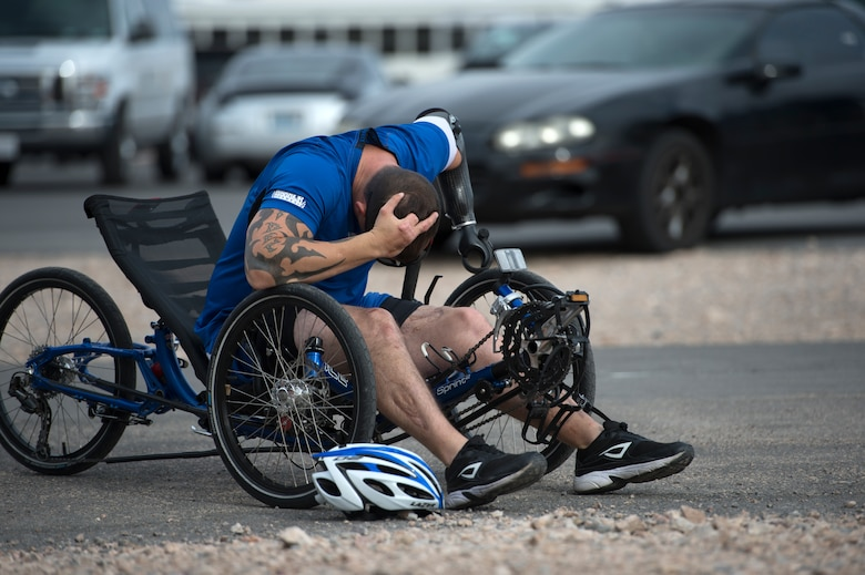 Leonard Anderson takes a moment to decompress after his race April 9, 2014, during the cycling portion of the Air Force Trials at Nellis Air Force Base, Nev.  Anderson, an Air Force wounded warrior, competed in the 12-mile men's recumbent heat for an opportunity to make it on a team for the Warrior Games and Invictus Games.  (U.S. Air Force photo/Senior Airman Jette Carr)
