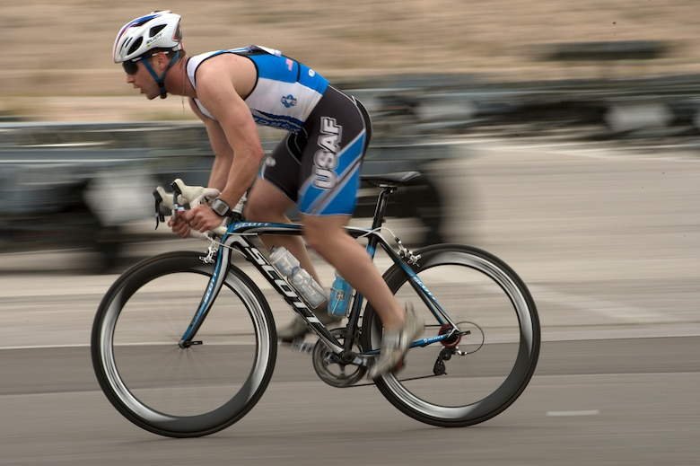 Mitchell Kieffer increases his speed while racing in the 18-mile men's bicycle open April 9, 2014, during the Air Force Trials at Nellis Air Force Base, Nev.  Kieffer, an Air Force wounded warrior, finished in first place for his category.   (U.S. Air Force photo/Senior Airman Jette Carr)
