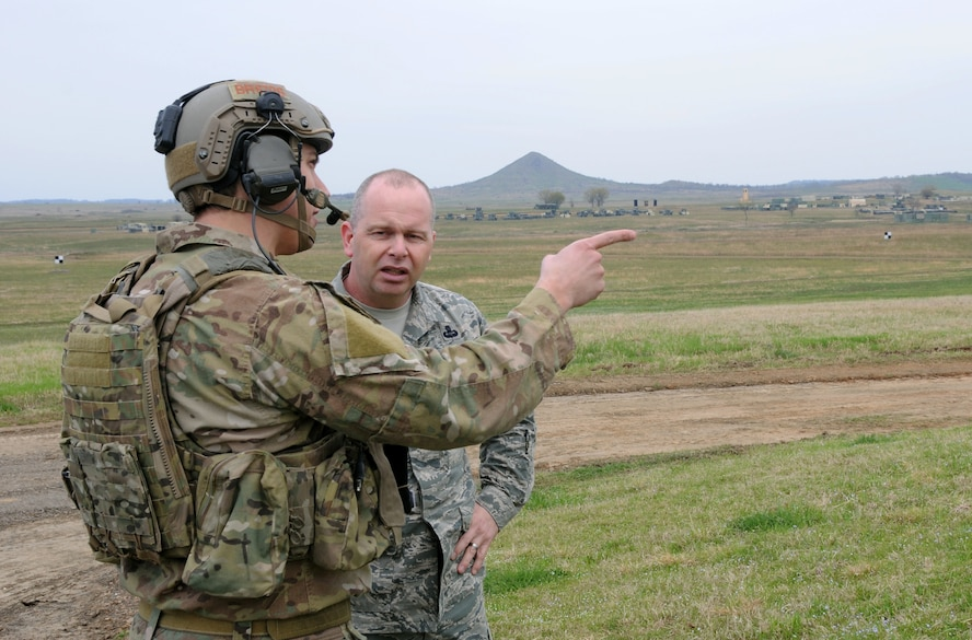 Air National Guard Command Chief Master Sgt. James W. Hotaling speaks with a joint terminal attack controller from the 22nd Special Tactics Squadron during a visit to the 188th Fighter Wing's Detachment 1 Razorback Range April 5, 2014. Hotaling, a former combat controller, met with JTACs to understand the unique training opportunities available at Razorback Range. The 188th's pilots regularly train with Special Forces JTACs from the U.S. Army Rangers, Air Force Special Operations and Naval Special Warfare teams. (U.S. Air National Guard photo by Senior Airman John Hillier/released)