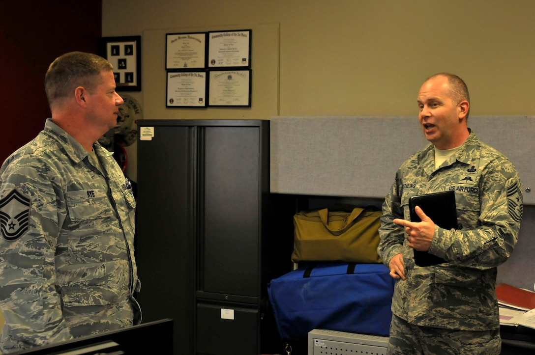 Air National Guard Command Chief Master Sgt. James W. Hotaling speaks with Senior Master Sgt. Damon Rye at Ebbing Air National Guard Base, Fort Smith, Ark., April 5, 2014. Hotaling visited with many different Airmen during his time at the 188th Fighter Wing. He also met with wing leadership before touring the unit's facilities. (U.S. Air National Guard photo by Airman 1st Class Cody Martin/Released)