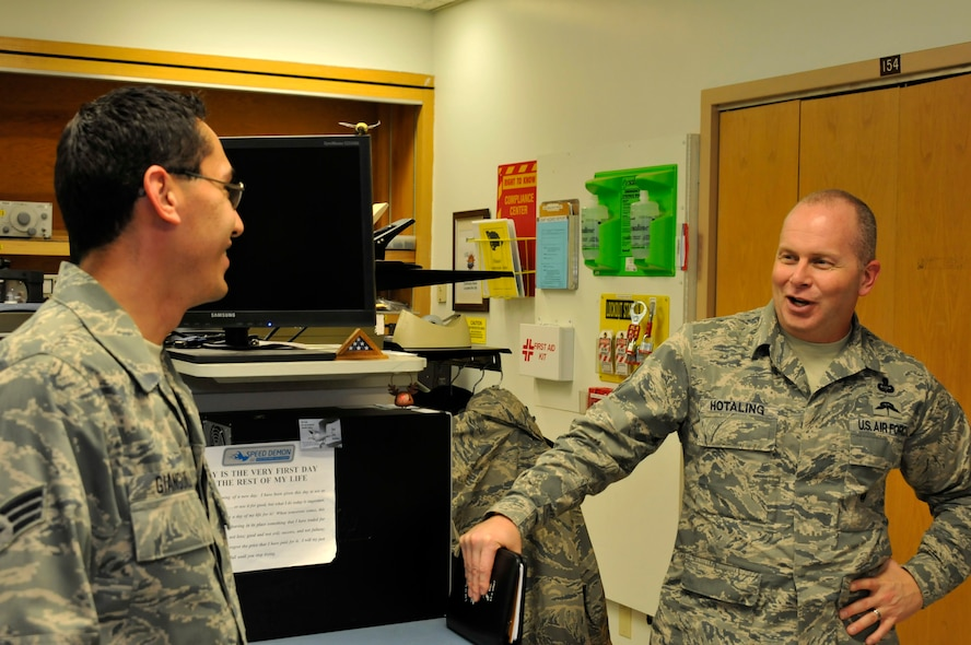 Air National Guard Command Chief Master Sgt. James W. Hotaling speaks with Senior Airman John Gianguilli at Ebbing Air National Guard Base, Fort Smith, Ark., April 5, 2014. Hotaling visited with many Airmen during his time at the 188th Fighter Wing. He also met with wing leadership before touring the unit's facilities.  (U.S. Air National Guard photo by Airman 1st Class Cody Martin/Released)