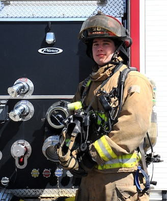 Staff Sgt. Michael Mullis, 341st Civil Engineer Squadron fire protection crew chief, poses in front of a Malmstrom Air Force Base fire truck. Mullis was recently named Air Force Firefighter of the Year. (U.S. Air Force photo/Airman 1st Class Joshua Smoot)