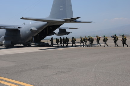 Honduran 2nd Combat Airborne Infantry Battalion paratroopers board a C-130 Hercules aircraft to perform a joint airborne operations training jump with the 7th Special Forces Group at Soto Cano Air Base, Honduras on April 3, 2014.  The 1,500 foot static line jump allowed members from both nations to retain currency, while also strengthening the relationship between the U.S. and Honduran forces.  (Photo by U. S. Air National Guard Capt. Steven Stubbs)