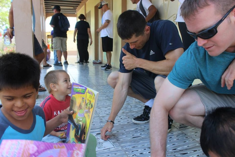 """Joint Task Force-Bravo's Medical Element (MEDEL) make a connection with the Hogar de Ninos, Nazareth boys orphanage on a Saturday morning.  The boys receive much needed supplies such as clothing, toiletries, and school items provided by volunteers from MEDEL.  The service members played soccer, colored pictures, and even took """"selfies"""" with the joyous children."""