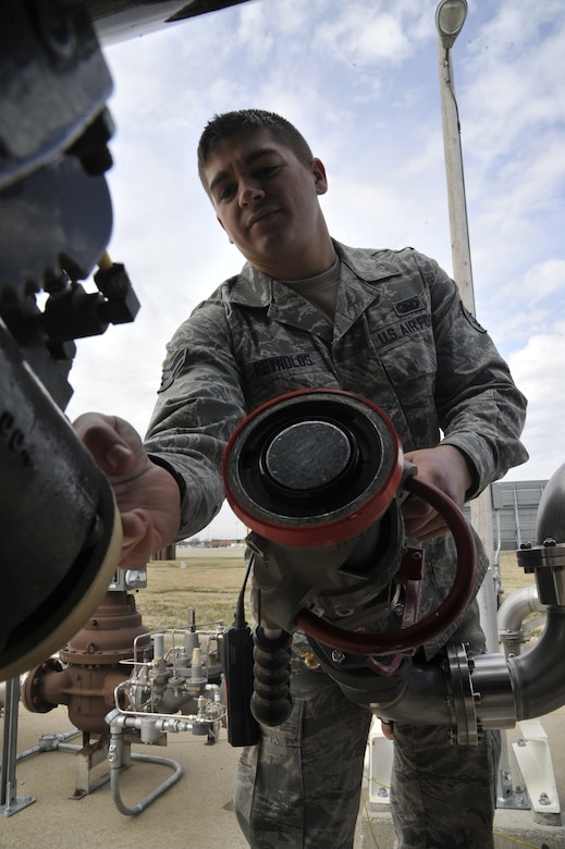 U.S. Air Force Airman 1st Class Joshua Reynolds, 509th Logistics Readiness Squadron fuels distribution technician, disconnects a single point nozzle from an R-11 fuel truck at Whiteman Air Force Base, Mo. April 1, 2014. The single point nozzle attaches to the bottom loader to verify that the metered fill issued prior to filling. (U.S. Air Force photo by Airman 1st Class Keenan Berry/Released)