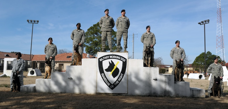 The 42nd Security Forces Squadron MWD team poses for a photo at Maxwell Air Force Base, 14 Feb. (U.S. Air Force photo by Senior Airman William Blankenship)