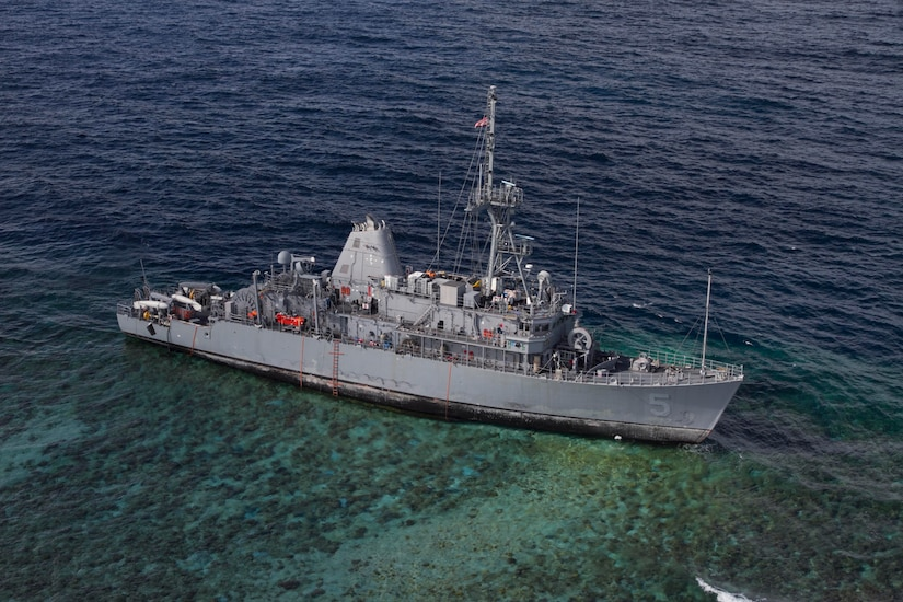The USS Guardian (MCM 5) is seen after the pounding of ocean waves pushed it onto Tubbataha Reef. Operations to safely recover the ship while minimizing environmental effects were conducted in close cooperation with allied Philippines Coast Guard and Navy. (U.S. Navy photo/Petty Officer 3rd class Geoffrey Trudell)