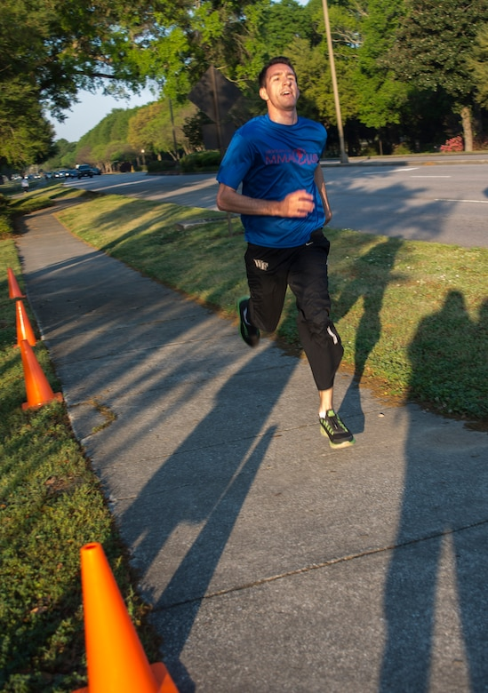 Airman 1st Class Anthony Tressel, 628th Communications Squadron radio frequency transmission systems technician, sprints to the finish line during the 5K Fitness Challenge Run Apr. 11, 2014, on Joint Base Charleston – Air Base, S.C. The Fitness Challenge is held monthly to test Team Charleston's fitness abilities. Tressel was the top male runner with a time of 18:12. (U.S. Air Force photo/ Airman 1st Class Clayton Cupit)