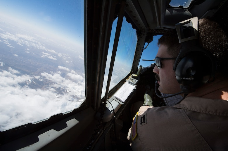 U.S. Air Force Capt. Christopher K. Jordan, 968th Expeditionary Airborne Air Control Squadron E-3/B Sentry pilot, scans the horizon while flying a combat sortie in support of Afghanistan Presidential Elections, April 4, 2014, over Afghanistan. The crew of the E-3/B flew the sortie marking the 968th EAACS's 4,000th combat sortie, since March 2007, when the squadron began combat operations in support of Operation Iraqi Freedom, Operation New Dawn and Operation Enduring Freedom. Jordan, a Little River, Kan. native, is deployed from the 963rd Airborne Air Control Squadron, Tinker Air Force Base, Ok. (U.S. Air Force photo by Tech. Sgt. Jason Robertson/Released)