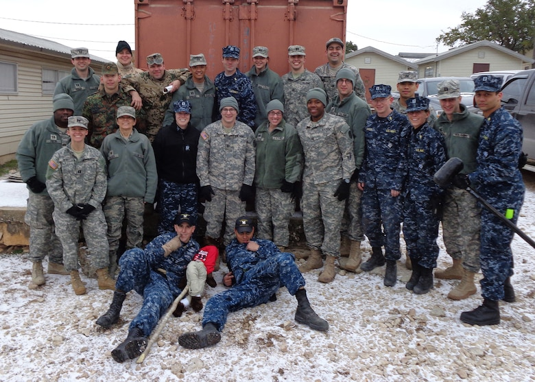 Maj. Deb Walker, a physician assistant assigned to the 153rd Medical Group, Wyoming Air National Guard, poses with classmates during an eight-day Combat Casualty Care Course held in Texas that began late January 2014. (Photo courtesy of Maj. Deb Walker)