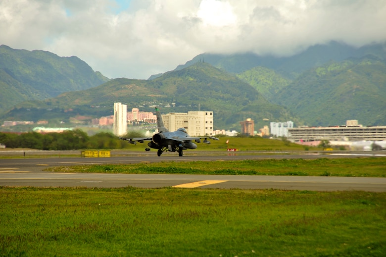 An F-16 Fighting Falcon from the 180th Fighter Wing, Ohio Air National Guard, takes off for an afternoon training sortie at Hickam Air Force Base, Hawaii, March 13, 2014. The 180th Fighter Wing is participating in Sentry Aloha, a large aerial combat training exercise, with nearly 50 different airframes from the Air National Guard, Air Force Reserves and Active Duty components. Sentry Aloha allows participating units to train like they would fight in combat, focusing on offensive and defensive counter air measures and fighter integration. Air National Guard photo by Master Sgt. Beth Holliker (Released).