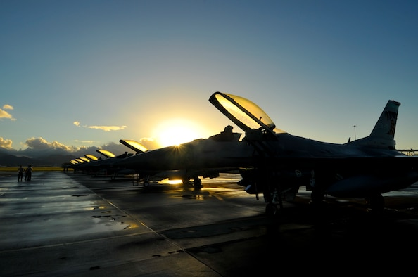 F-16 Fighting Falcons from the 180th Fighter Wing, Ohio Air National Guard, stand ready for a morning training sortie at Hickam Air Force Base, Hawaii, March 13, 2014. The 180th Fighter Wing is participating in Sentry Aloha, a large aerial combat training exercise, with nearly 50 different airframes from the Air National Guard, Air Force Reserves and Active Duty components. Sentry Aloha allows participating units to train like they would fight in combat, focusing on offensive and defensive counter air measures and fighter integration. Air National Guard photo by Master Sgt. Beth Holliker (Released).