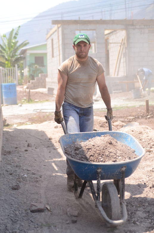 Twenty-one Joint Task Force-Bravo service members filled trenches, leveled ground and shoveled dirt at the Ajuterique Housing Project helping several Honduran families get closer to moving into their new homes April 5, 2014.  In conjunction with the Honduras Habit for Humanity, Siguatepeque region, the Municipality of Ajuterique and the Civil-Military Operations office at JTF-Bravo, these service members volunteered their labor to assist in the building of homes in the Ajuterique community.  The two-phased project includes building 38 two-bedroom, one-bath homes for low-income Hondurans who can afford to construct a home but doesn't own the land to build on. (Photo by U. S. Air Force Technical Sgt. Breihan Fetz)