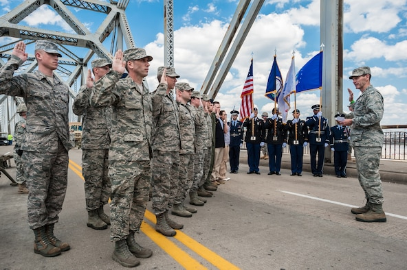 Lt. Gen. Stanley E. Clarke III, director of the Air National Guard, administers the oath of enlistment to 15 members of the Kentucky Air National Guard on the 2nd Street Bridge in Louisville, Ky., April 12, 2014. The event kicked off Thunder Over Louisville, the city's annual air show and fireworks display over the Ohio River. (U.S. Air National Guard photo by Maj. Dale Greer)