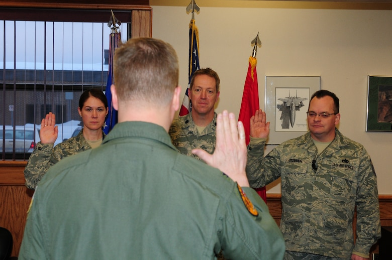 Master Sgt. Jennifer Long, Lt. Col. Thomas Ruud and Master Sgt. Sean O?Connor take the Inspector General (IG) oath of office from Col. Jon Safstrom, 148th Fighter Wing, Vice Wing Commander, Jan. 14, 2014.  The three members are part of the 148th Fighter Wing IG team and will execute the Wing Commander?s Inspection Program.  (U.S. Air National Guard photo by Master Sgt. Ralph Kapustka/Released)