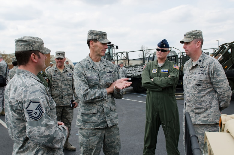Lt. Gen. Stanley E. Clarke III, director of the Air National Guard, speaks with Lt. Col. David Mounkes (second from right) and Lt. Col. Bruce Bancroft (far right) of the 123rd Contingency Response Group during a tour of the Kentucky Air National Guard Base in Louisville, Ky., April 11, 2014. Clarke visited with Airmen from across the 123rd Airlift Wing and examined mission capabilities ranging from contingency response to special tactics. (U.S. Air National Guard photo by Airman 1st Class Joshua Horton)