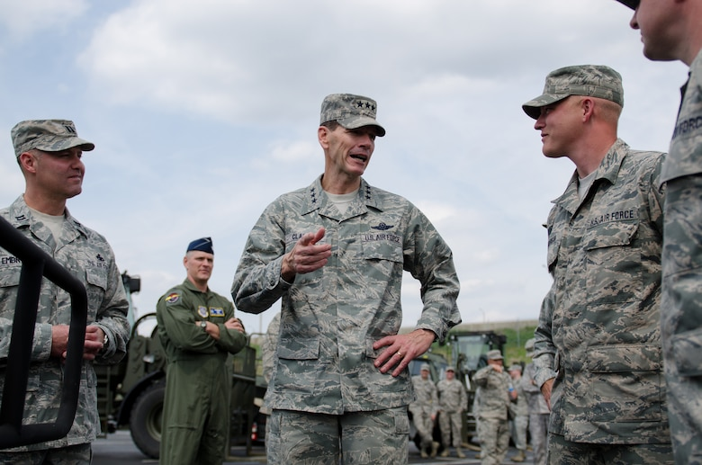 Lt. Gen. Stanley E. Clarke III, director of the Air National Guard, speaks with Master Sgt. Matt Hourigan of the 123rd Contingency Response Group during a tour of the Kentucky Air National Guard Base in Louisville, Ky., April 11, 2014. Clarke visited with Airmen from across the 123rd Airlift Wing and examined mission capabilities ranging from contingency response to special tactics. (U.S. Air National Guard photo by Airman 1st Class Joshua Horton)