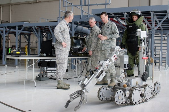 Senior Master Sgt. Shane LaGrone of the 123rd Explosive Ordnance Disposal Flight demonstrates an EOD robot to Lt. Gen. Stanley E. Clarke III, director of the Air National Guard, during a tour of the Kentucky Air National Guard Base in Louisville, Ky., April 11, 2014. Clarke visited with Airmen from across the 123rd Airlift Wing and examined mission capabilities ranging from contingency response to special tactics. (U.S. Air National Guard photo by Airman 1st Class Joshua Horton)