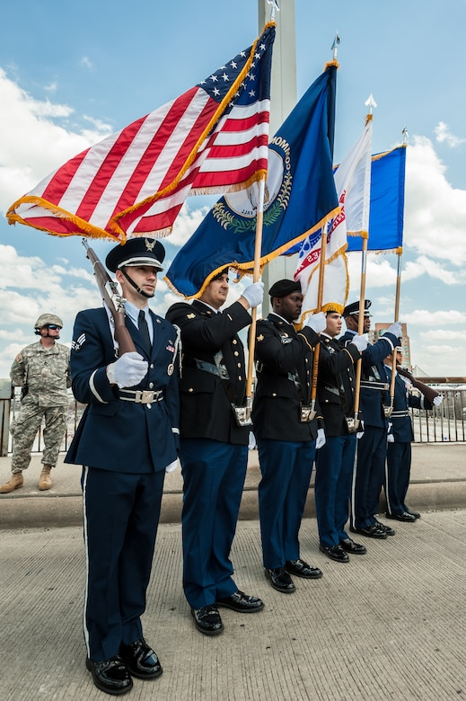 A joint Color Guard, comprised of members from the Kentucky Army and Air National Guard, present the colors on the 2nd Street Bridge in Louisville, Ky., April 12, 2014, to begin the Thunder Over Louisville air show. The show drew more than 650,000 spectators this year. (U.S. Air National Guard photo by Maj. Dale Greer)