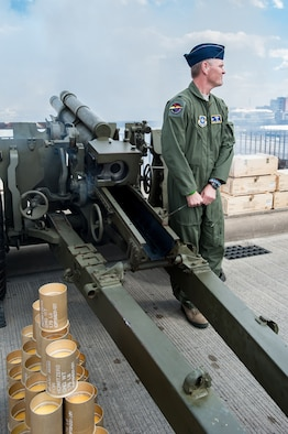 Col. Barry Gorter, commander of the Kentucky Air National Guard's 123rd Airlift Wing, fires a Kentucky Army Guard Howitzer on the 2nd Street Bridge in Louisville, Ky., April 12, 2014, as part of the Thunder Over Louisville air show's opening ceremony. The show drew more than 650,000 spectators this year. (U.S. Air National Guard photo by Maj. Dale Greer)