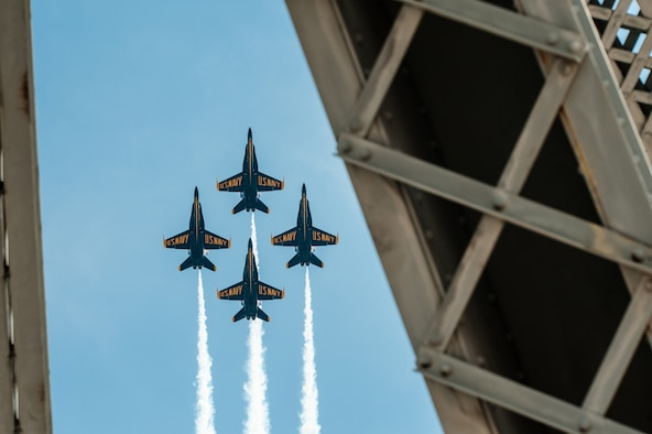 The U.S. Navy's Blue Angels demonstration squadron performs aerobatic maneuvers over the Ohio River and 2nd Street Bridge in Louisville, Ky., April 12, 2014. More than 650,000 spectators turned out for the event, which was part of the annual Thunder Over Louisville air show. (U.S. Air National Guard photo by Maj. Dale Greer)