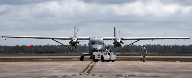 A C-145 Skytruck is towed back to its parking area after routine maintenance at Duke Field, Fla. The Aviation Foreign Internal Defense and Skytruck mission is a joint active-duty and reserve Air Force Special Operations Command mission.  (U.S. Air Force photo/Tech. Sgt. Samuel King Jr.)