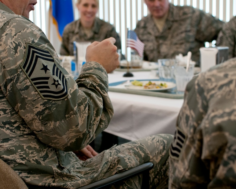 Chief Master Sgt. James Hotaling, Command Chief of the Air National Guard, eats lunch with Honor Airmen from the 133rd Airlift Wing in St. Paul Minn., Apr. 12, 2014. Chief Hotaling visited the wing to discuss the health of the Air Force, our commitment to the Profession of Arms and answered questions from Airmen. (U.S. Air National Guard photo by Staff Sgt. Austen Adriaens/Released)