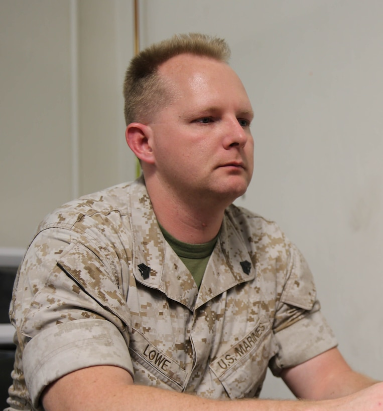 Sergeant Stephen Lowe, an armory custodian with 2nd Marine Division aboard Marine Corps base Camp Lejeune, was awarded the Navy and Marine Corps Medal recently for actions while on Marine security guard duty in Lagos, Nigeria, April 28, 2013.