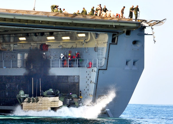 All Networking On-the-Move-equipped Assault Amphibious Vehicle testing was conducted within a realistic, operational framework. This included transitioning of the NOTM-AAV in and out of surf, traveling extended distances in differing sea states and terrain surfaces, and the boarding and disembarking from the USS Anchorage, the amphibious transport dock ship shown here operating off the coast of Camp Pendleton, Calif.