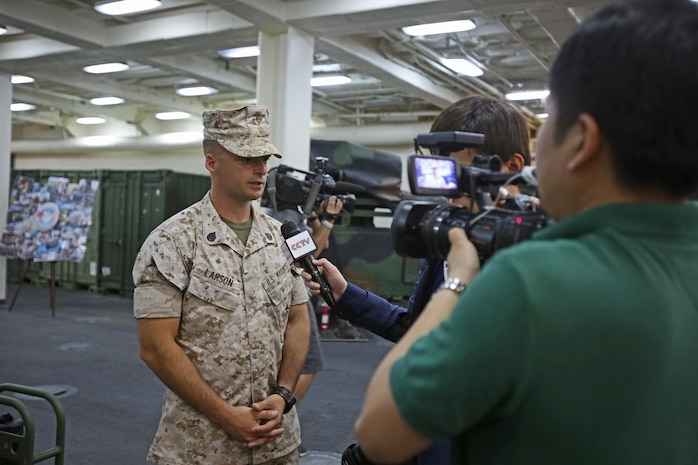 Staff Sgt. Ross Larson, a combat engineer with 7th Engineer Support Battalion, attached to Special Purpose Marine Air-Ground Task Force Association of South East Asian Nations, briefs international media personnel on the MAGTF's humanitarian aid capabilities during a static display aboard amphibious transport dock ship USS Anchorage (LPD 23) in support of the ASEAN conference held by U.S. Secretary of Defense Chuck Hagel in Hawaii, April 2, 2014. Delegates and media personnel, from 10 Southeast Asian countries, attended the exhibit to learn more about the Navy and Marine Corps' humanitarian aid and disaster relief capabilities. As subject matter experts with firsthand experience on their equipment, the Marines and sailors who participated were able to increase the international public's understanding of what the Navy-Marine Corps team can do during disaster situations, and built rapport with foreign officials and militaries.