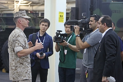 Lieutenant Col. Mark T. Donar, commanding officer, Special Purpose Marine Air-Ground Task Force Association of South East Asian Nations, briefs international media personnel on the MAGTF's humanitarian aid and disaster relief capabilities during a static display aboard amphibious transport dock ship USS Anchorage (LPD 23) in support of the ASEAN conference held by U.S. Secretary of Defense Chuck Hagel in Hawaii, April 2, 2014. Delegates and media personnel, from 10 Southeast Asian countries, attended the exhibit to learn more about the Navy and Marine Corps' aid capabilities. As subject matter experts with firsthand experience on their equipment, the Marines and sailors who participated were able to increase the international public's understanding of what the Navy-Marine Corps team can do during disaster situations, and built rapport with foreign officials and militaries.