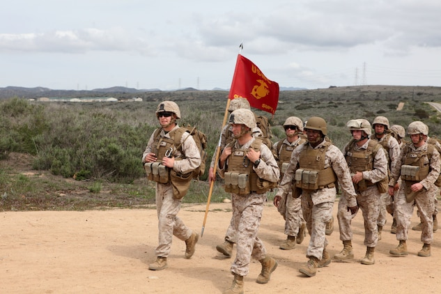 Marines with Headquarters and Support Company, Combat Logistics Battalion 5, Combat Logistics Regiment 1, 1st Marine Logistics Group, conduct a combat conditioning hike to the Leadership Reaction Course aboard Camp Pendleton, Calif., April 4, 2014. After completing the hike and an obstacle course, the Marines divided into teams and split between 12 stations. The course is designed to build leadership traits and further develop the bonds between Marines. (U.S. Marine Corps photo by Lance Cpl. Keenan Zelazoski/ Released)