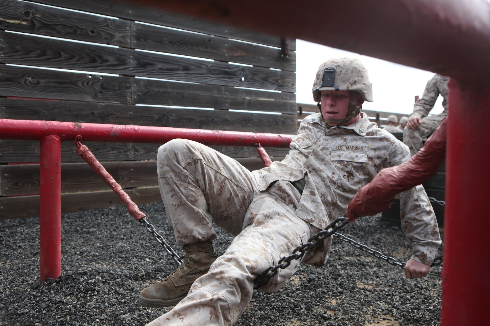 Corporal Jeffrey Samples, motor transport operator, Combat Logistics Battalion 5, Combat Logistics Regiment 1, 1st Marine Logistics Group, cautiously makes his way across an obstacle during the Leadership Reaction Course aboard Camp Pendleton, Calif., April 4, 2014. The course is designed to build leadership traits and further develop the bonds between Marines.