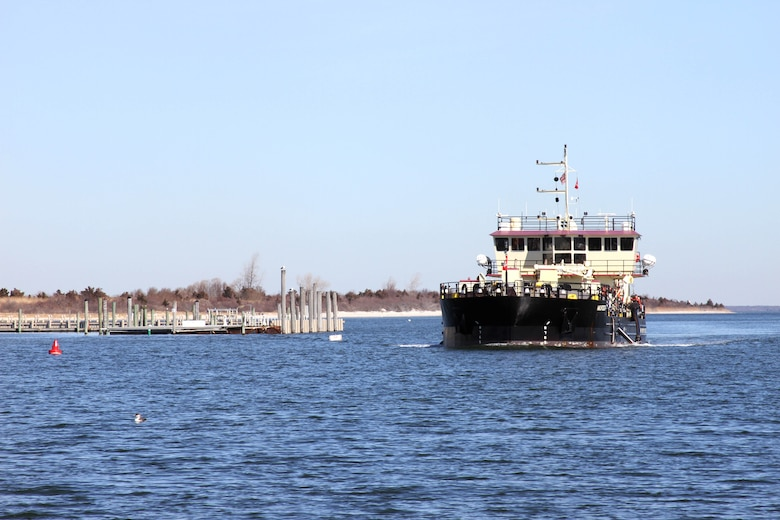 The Shallow Draft Dredge MURDEN clears shoaling from Barnegat Inlet, N.J. in April of 2014. The vessel was designed by the U.S. Army Corps of Engineers' Marine Design Center in Philadelphia and is based out of Wilmington, N.C. Barnegat Inlet requires dredging to provide reliable maritime navigation for the U.S. Coast Guard and a large fishing fleet consisting of full-time commercial, charter and recreational vessels.