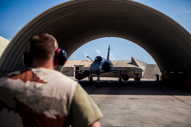 A French air force Mirage 2000 fighter jet with Fighter Squadron 03/011 Corsica begins to taxi to a runway at French Airbase 188 during an air-to-air combat exercise with AV-8B Harriers assigned to Marine Medium Tiltrotor Squadron (VMM) 263 (Reinforced), 22nd Marine Expeditionary Unit (MEU). The 22nd MEU is deployed with the Bataan Amphibious Ready Group as a theater reserve and crisis response force throughout U.S. Central Command and the U.S. 5th Fleet area of responsibility.