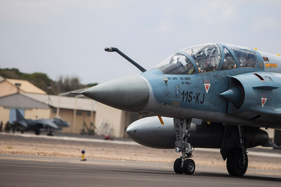 A French air force Mirage 2000 fighter jet with Fighter Squadron 03/011 Corsica taxis to a runway at French Airbase 188 during an air-to-air combat exercise with AV-8B Harriers from Marine Medium Tiltrotor Squadron (VMM) 263 (Reinforced), 22nd Marine Expeditionary Unit (MEU). The 22nd MEU is deployed with the Bataan Amphibious Ready Group as a theater reserve and crisis response force throughout U.S. Central Command and the U.S. 5th Fleet area of responsibility.