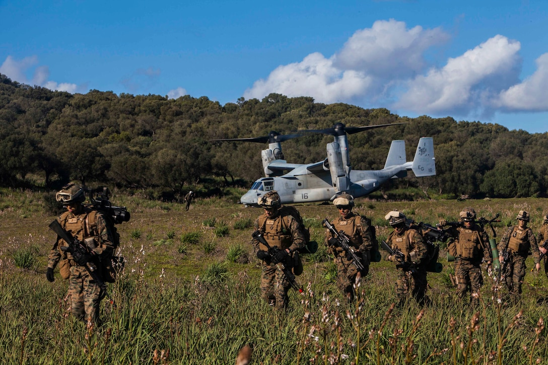 U.S. Marines with Battalion Landing Team 1st Battalion, 6th Marine Regiment, 22nd Marine Expeditionary Unit (MEU), exit a U.S. Marine Corps MV-22 Osprey aircraft with Marine Medium Tiltrotor Squadron (VMM) 263 (Reinforced), at a training range in Sierra del Retín, Spain, during Spanish Amphibious Bilateral Exercise (PHIBLEX) 2014 Feb. 24, 2014. Spanish PHIBLEX is an annual exercise designed to improve interoperability, increase readiness and develop professional and personal relationships between U.S. forces and participating nations. The MEU is deployed to the U.S. 6th Fleet area of responsibility with the Bataan Amphibious Ready Group as a sea-based, expeditionary crisis response force capable of conducting amphibious missions across the full range of military operations.