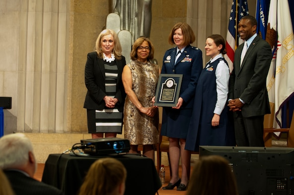 Members of the Air Force Judge Advocate General's Corps pose for an awards photo after receiving the Federal Service Award from the Department of Justice, during the 2014 Justice Department's National Crime Victims' Rights Service Awards ceremony, April 9, 2014, at the Department of Justice, Washington D.C. The JAG Corps received the  Award for the implementation and administration of the Special Victims' Counsel program.  (U.S. Air Force photo/Staff Sgt. Carlin Leslie)