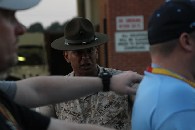 U.S. Marine Corps Staff Sgt. David R. McFadden, a drill instructor at Marine Corps Recruit Depot Parris Island, S.C., motivates educators during Recruiting Station Detroit's Educator Workshop at MCRD Parris Island April 3, 2014. The Educator Workshop is an annual program conducted by recruiting stations across the United States with the goal of enhancing educator's knowledge about the Marine Corps for when they advise their students about possible career paths. (U.S. Marine Corps photo by Cpl. Tyler Birky/Released)