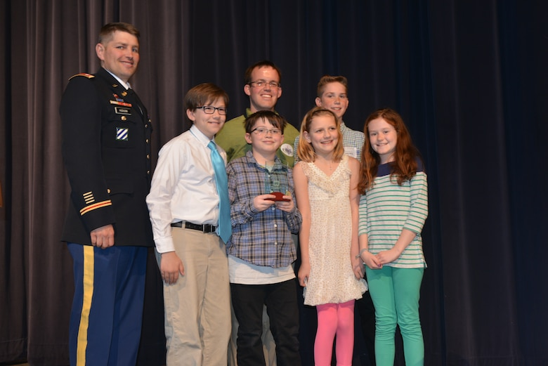 Lt. Col. John L. Hudson, Nashville District commander, (left) recognized students and faculty from the Jack Anderson Elementary school, and presented a glass trophy and certificate to them for their STEM project on Wind Energy and Hydropower at the Volunteer State Community College, April 11, 2014.