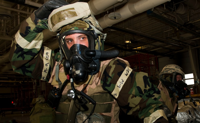 Tech. Sgt. Kurt Trauch, 366th Civil Engineer Squadron firefighter, practices donning his chemical gear during the weeklong Sharpshooter 14-02 exercise April 15, 2014, Mountain Home Air Force Base, Idaho. (U.S. Air Force photo by Airman 1st Class Malissa Lott)