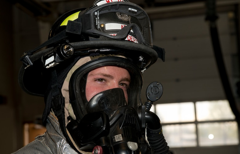 Senior Airman Westine Devine, 366th Civil Engineer Squadron firefighter, stands in full firefighter mission-oriented protective posture gear before operations during the Sharpshooter 14-02 exercise April 15, 2014, Mountain Home Air Force Base, Idaho. Firefighters must wear normal chemical gear as well as fire retardant gear when responding to fires in a chemical environment. (U.S. Air Force photo by Airman 1st Class Malissa Lott)