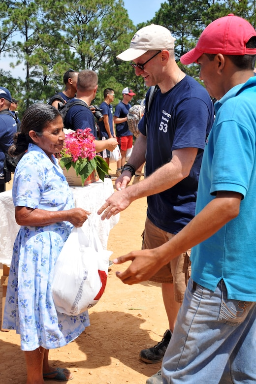More than 130 members of Joint Task Force-Bravo completed a 6.2 mile round trip hike to deliver more than 3,000 pounds of food and supplies to families in need in the mountain village, April 12, 2014. During the more than three mile trek up the mountain, Task Force members made an elevation gain of 1,600 feet while carrying more than 25 pounds of supplies each. The food and supplies were all purchased with donations made by the members of Joint Task Force-Bravo. (Photo by Ana Fonseca)