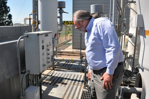 Ken Smarkel, an AFCEC contractor and groundwater remediation program manager at the former McClellan Air Force Base, checks a soil vapor extraction system at that location in Sacramento, Calif. (U.S. Air Force photo/Scott Johnston)
