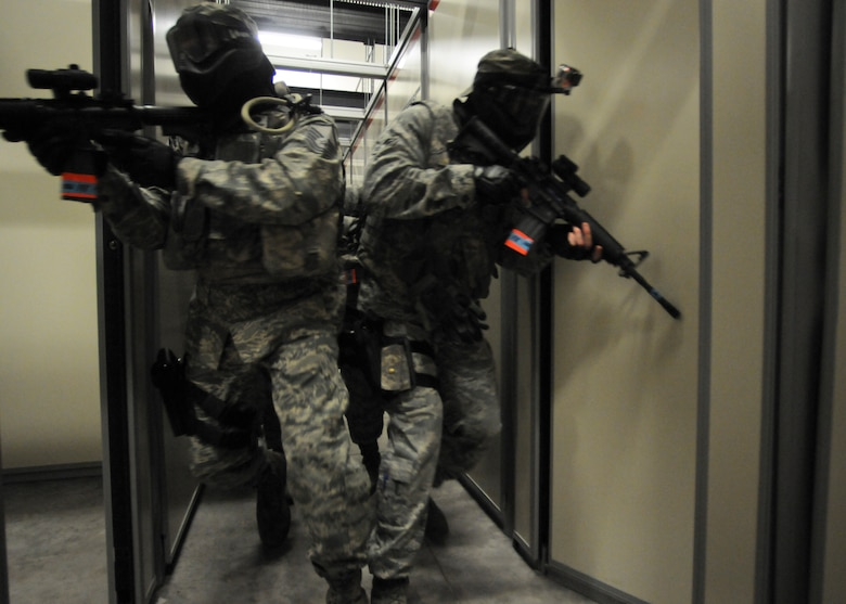 Members of the 125th Security Forces Squadron perform close quarters combat training at Camp Blanding Joint Training Base, Fla. on Apr. 11, 2014. (U.S. Air National Guard photo by Staff Sgt. Jeremy L. Brownfield) (Released)